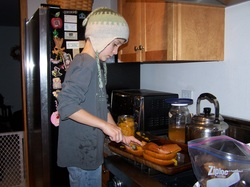 My son preparing roasted pumpkin last year.